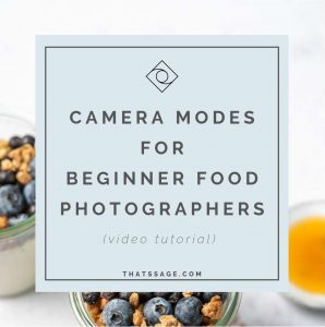 "an image of a parfait with blueberries and granola with the text ""Camera Modes for Beginner Food Photographers"" overlaying the image. photograph by Lauren Caris Short of Food Photography Academy"