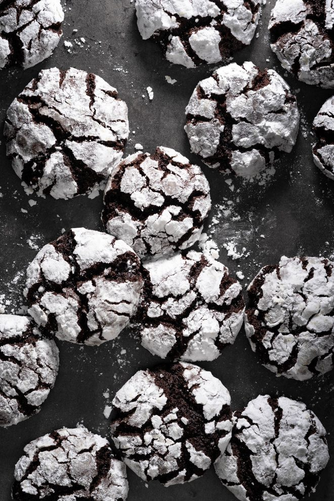A pile of crinkle cookies with icing sugar, photograph by Lauren Caris Short of Food Photography Academy