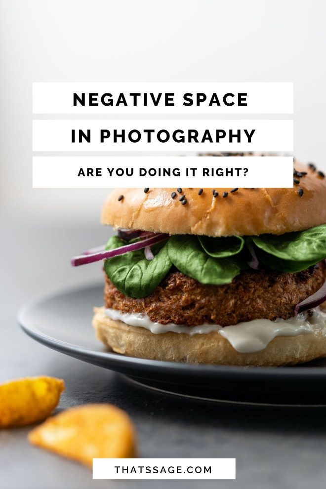 "Close up shot of a cheeseburger set against a white-gray background. Text on mage reads ""Negative Space in Photography: Are you doing it right?"" Photograph by Lauren Caris Short of Food Photography Academy."