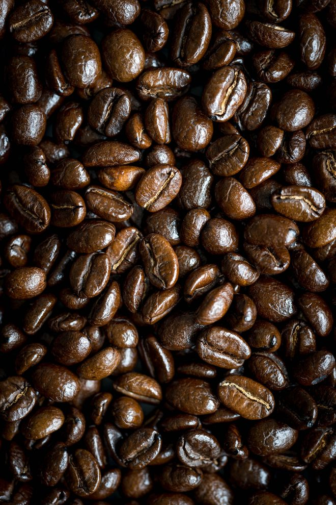 Close up shot of roasted coffee beans, an example of macro pattern. Photograph by Lauren Caris Short of Food Photography Academy.